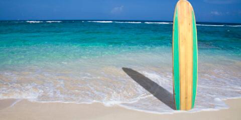 surfbrett im sand_online1